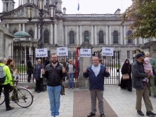 Protesters gather outside Belfast City Hall . . .