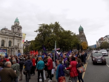 People gather outside Belfast City hall to protest in favor of letting refugees into Ireland.