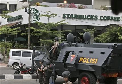A police armored vehicle is parked outside a Starbucks Cafe near where an explosion went off in Jakarta, Indonesia Thursday, Jan. 14, 2016. Attackers set off explosions at a Starbucks cafe in a bustling shopping area of downtown Jakarta and waged gun-battles with police Thursday, leaving bodies in the streets as office workers watched in terror from high-rise windows. (AP Photo/Achmad Ibrahim)